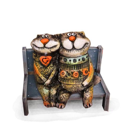 коты сидящие